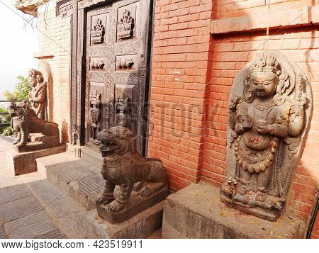 Sculpture Deity Guardian And Carving Lion Stone Figure At Ancient Ruins Antique Building Of Swayambh