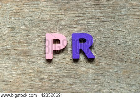 Color Alphabet Letter In Word Pr (abbreviation Of Purchase Requisition Or Public Relations) On Wood