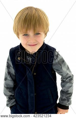 Portrait Of Little Boy In Casual Outfit. Cheerful Kid Wearing Long Sleeve Shirt And Warm Jacket Stan