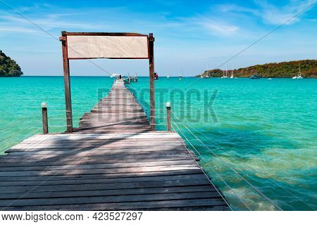 The Wooden Bridge In The Sea At Koh Kood Is A Tropical Island With Emerald Green Water And Beautiful