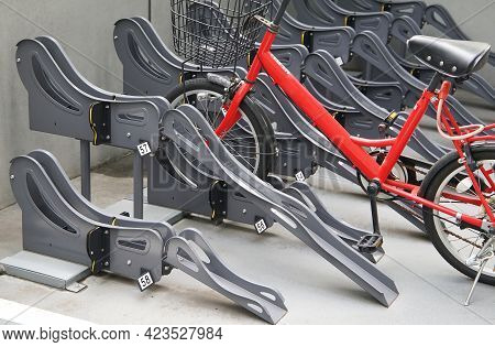 Many Stands At Outdoor Bicycle Parking Lots In Japan