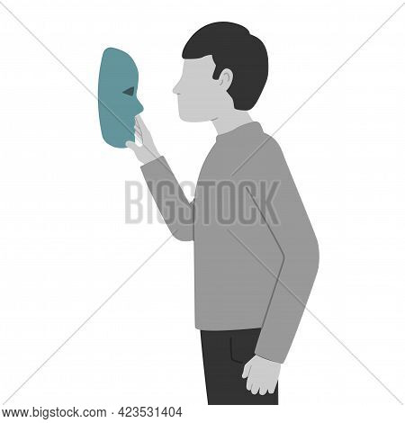 The Guy Holds A Theater Mask In His Hand And Looks At It. The Concept Of Impostor Syndrome. The Pers
