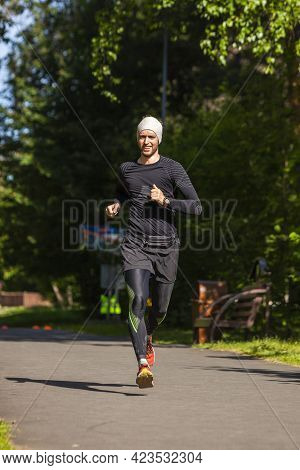 Running Young Man In The Park