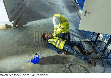 Supervisor First Aid Help Injured Worker Accident Electric Shock Unconscious. Asian Electrician Work