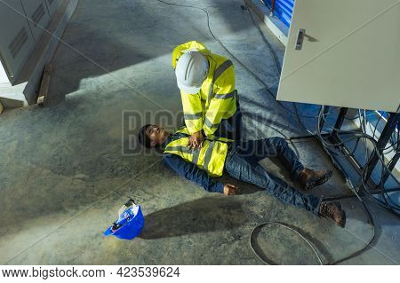 Supervisor Cpr For First Aid Maintenance Worker Accident Electric Shock Unconscious. Asian Electrici