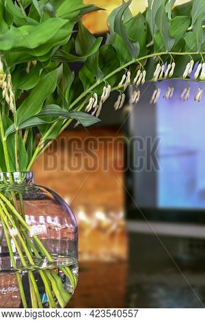 A Bouquet Of White Flowers In A Transparent Glass Round Vase On The Table. Decoration For A House, T
