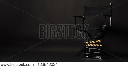 Black Director Chair And Clapper Board Or Movie Clapperboard On Black Background.use In Video Produc