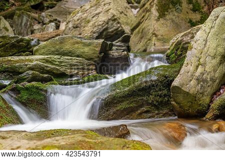 Silky Effect Of Cascades Of Running Water In A Brook. Your Object Can Be Placed On A Stone In The Fo