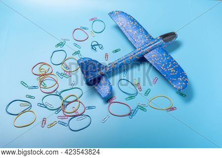 Flying Plane. Toy Plane And Colorful Circles. Departing Plane.