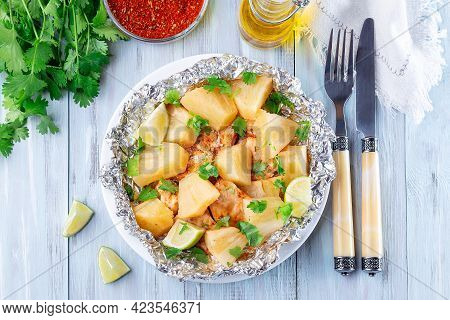 Baked In A Foil Packet Cajun Pineapple Chicken, Garnished With Lime And Cilantro, Horizontal, Top Vi