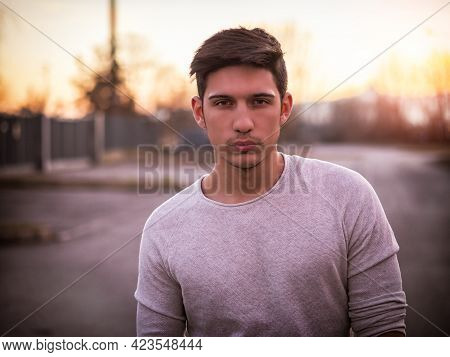 Handsome Young Man In White Sweater Outdoor In Street