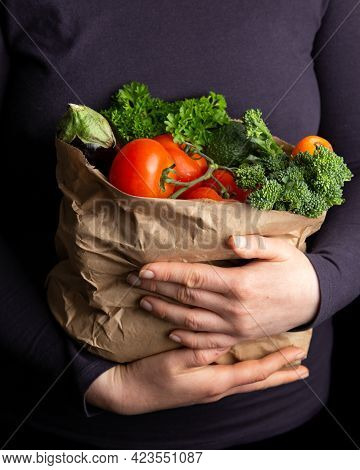 Woman Holding Paper Carrier Bags, Full Of Fresh Raw Vegetables. Healthy Food.