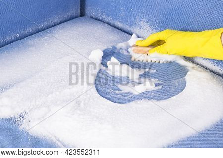 Hand In A Rubber Glove Dry-cleaning Upholstered Furniture With A Brush, Close-up