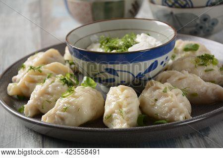 Homemade Dumplings, Dagestan Cuisine, Kurze. Dumplings Kurze With Meet Filling, And Adjika Hot Sauce