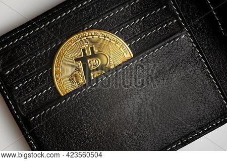 Men's Wallet With Bitcoin, Top View Of Black Purse And Gold Bit Coin (btc). Open Leather Pocket And