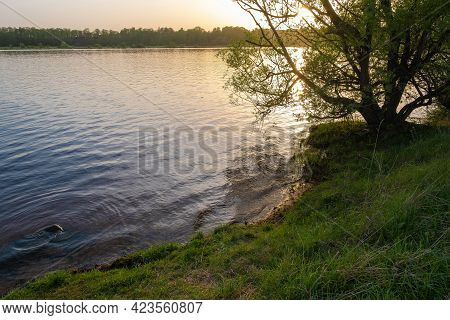 Evening On The Volga River With The Setting Orange Sun And Calm Calm Water, Russia.