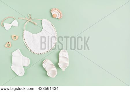 Mockup Of Empty Frame With White Baby Accessories. Baby Shower, Baptism Invitation