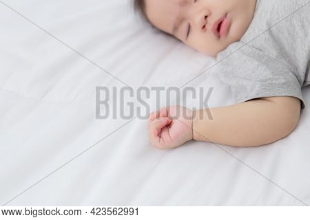 Portrait Of Asian Little Baby Girl Sleeping On Bed In The Bedroom At Home, Newborn Napping With Cozy