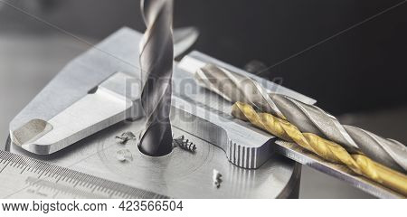 Drill Bit Make Holes In Steel Billet On Industrial Drilling Machine With Ruler And Caliper. Metal Wo