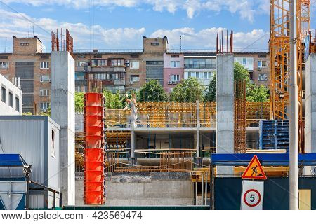 Orange Industrial Formwork Is Used At The Construction Site For The Construction Of Reinforced Concr