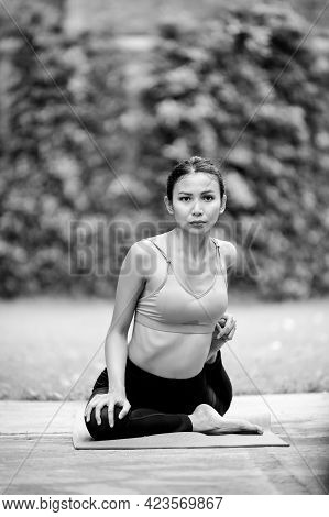 Asian Women Meditation And Stretching Relax Their Muscles By Doing Yoga In The Garden