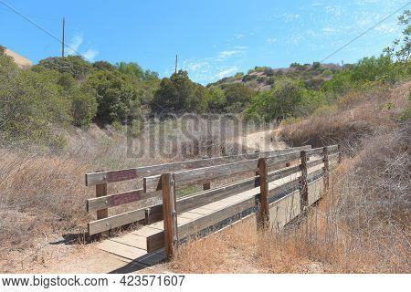 BREA, CALIFORNIA - 9 JUN 2021: Wooden footbridge on the trail at the Olinda Oil Museum and Trail.