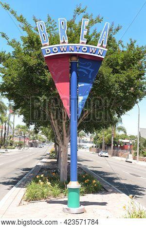 BREA, CALIFORNIA - 9 JUN 2021: Downtown Brea sign on Brea Boulevard across from City Hall Park.