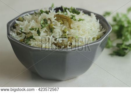 Green Peas Pulav. A One Pot Rice Preparation With Basmati Rice, Green Peas And Spices In Ghee.