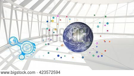 Composition of network of connections with icons over globe in modern office. global connections and digital interface concept digitally generated image.