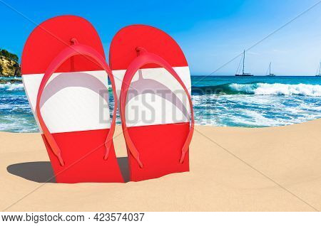 Flip Flops With Austrian Flag On The Beach. Austria Resorts, Vacation, Tours, Travel Packages Concep