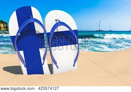 Flip Flops With Finnish Flag On The Beach. Finland Resorts, Vacation, Tours, Travel Packages Concept