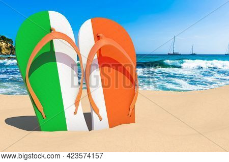 Flip Flops With Irish Flag On The Beach. Ireland Resorts, Vacation, Tours, Travel Packages Concept.