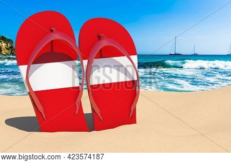 Flip Flops With Latvian Flag On The Beach. Latvia Resorts, Vacation, Tours, Travel Packages Concept.