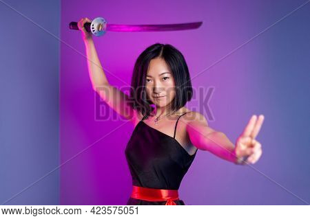 Slender Asian Woman In A Black Dress With A Katana In Her Hand Image Of A Samurai On A Neon Backgrou