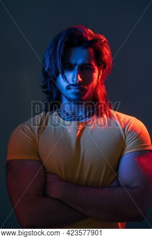 Macho Man. Masculine Power. Cyberpunk Fashion Portrait. Neon Light People. Confident Guy Yellow T-sh