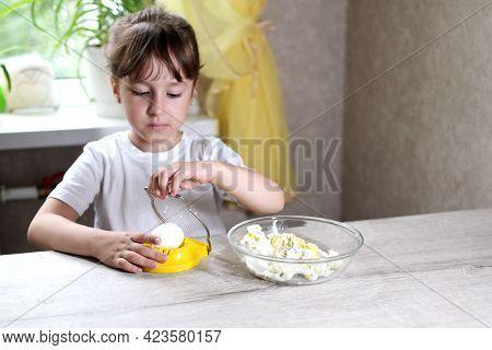 Lifestyle Preschooler Child Girl Cook Food In The Kitchen. Development Of Fine Motor Skills In Every