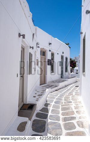 Mykonos, Greece. Traditional White Buildings And Narrow Streets, Blue Sky Background