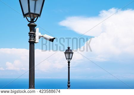 Security Camera On A Light Pole On The Street. Cctv Surveillance Security Camera Video Equipment. Ho