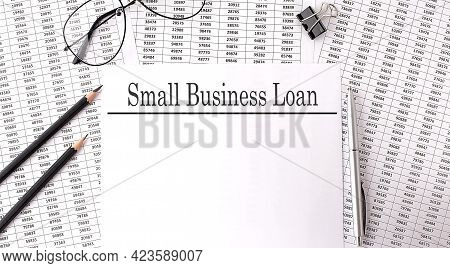 Paper With Small Business Loan Action Plans On Table With Chart And Pencils