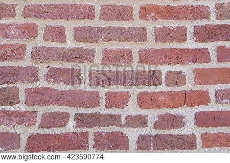 Close-up Of An Old Red Brick Wall. Background, Texture. Selective Focus.