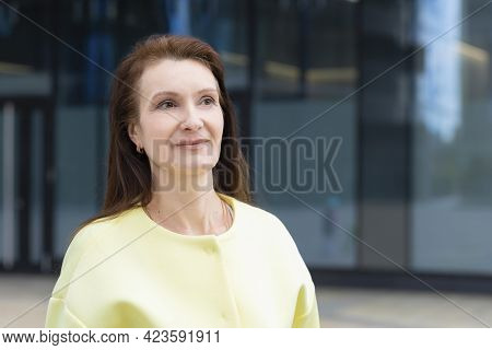 Portrait Happy Adult Businesswoman, Smiling Mature Middle Aged Woman. Attractive Lady Posing In Sunn