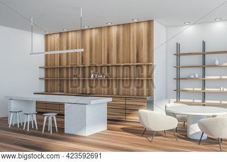Modern Kitchen Interior With Round Table, Armchairs And Bar Chairs, Side View. Rack With Decoration
