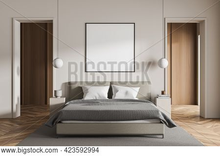 Light Bedroom Interior With Bed And Grey Carpet, Parquet Floor And Coffee Tables With Books And Lamp