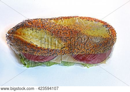 Healthy Ham And Tomato Sandwich Packed Inside Cellophane Wrap Isolated On White Background