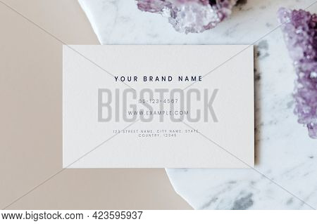 Business card mockup on a marble countertop