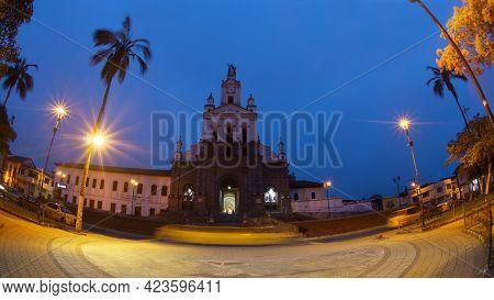 Cotacachi, Imbabura / Ecuador - June 13 2021: Night View Of Vehicles Circulating In Front Of The Cat