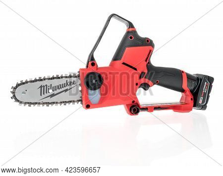 Winneconne, Wi - 10 June 2021:  A Package Of Milwaukee Hatchet Chainsaw Battery M12 On An Isolated B