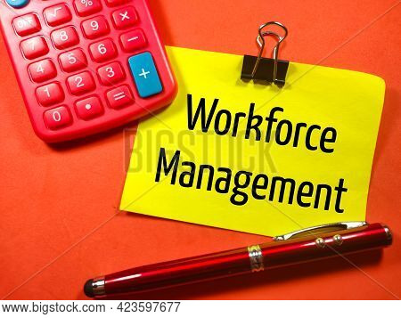 Business Concept.text Workforce Management On Colorful Paper Note With Calculator And Pen On Red Bac