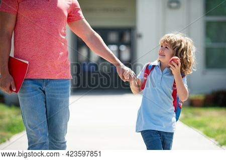 Father And Son Run With Father Come Back From School. Family, Education And Outdoor Concept. Father