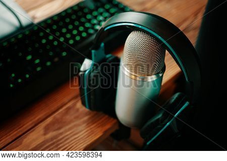 Tools For Broadcasting For Podcasting. Microphone With Keyboard And Headphones In Radio Or Podcast S